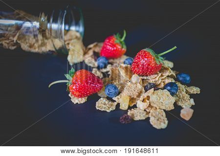 whole grain cereal flakes which mixed berry fruit and raisins. Cereal breakfast with strawberry. cereal cornflake