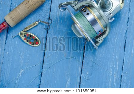 Spoon-baiting, Spinning And Reel. Decorative Background.