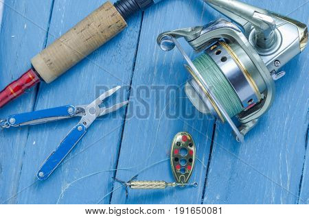 Spinning, Spool, Baits And Pliers. The Bait And The Tool Of A Fisherman.