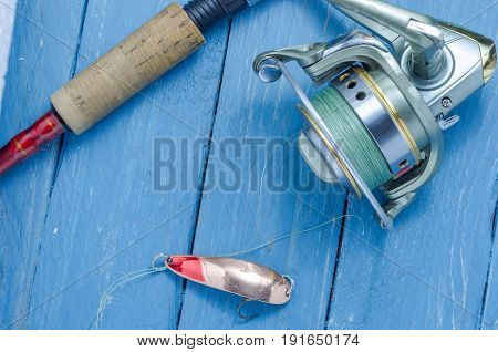 Spinning, Reel, Fishing Lure Yellow-red. The Bait And The Tool Of A Fisherman.