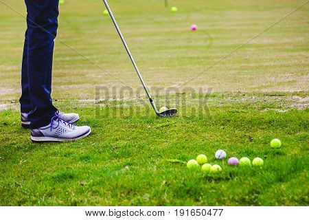 Golfplayer Hits A Ball