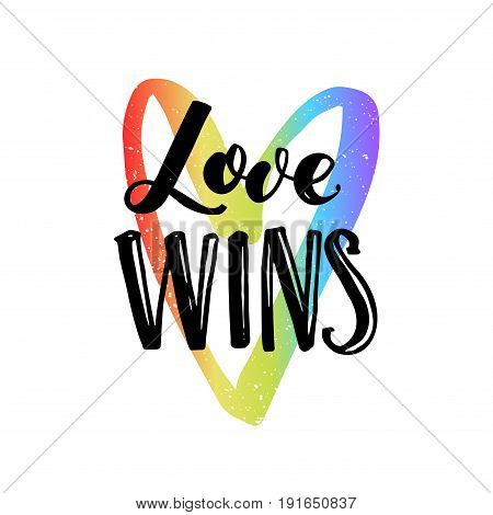 Love wins. Inspirational quote on rainbow heart, LGBT pride slogan for t-shirt, posters and cards.