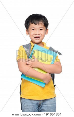 Portrait of cute smiling boy with backpack and colorful book education and back to school concept