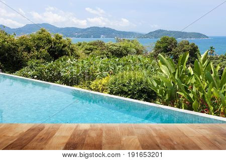 Swimming pool overlooking view andaman sea mountains and blue sky backgroundsummer holiday background concept