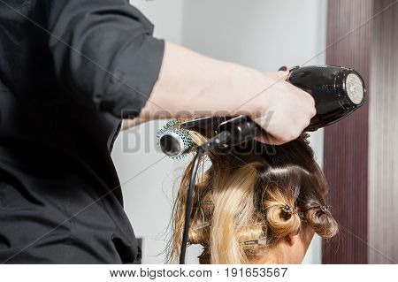 Woman at hairdresser getting a new hairstyle. Professional service. New hairstyle. Stylist at work