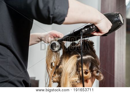 Gorgeous Woman at hairdresser getting a new hairstyle. Professional service. New hairstyle. Stylist at work
