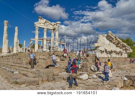 BERGAMA, TURKEY - SEPTEMBER 30: Temple of Trajan at Acropolis of Pergamon with tourist goup on September 30, 2011 in Bergama, Turkey.