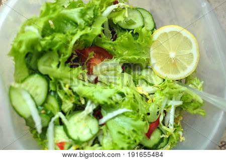 Fresh Vegetable Salad With Tomato, Cucumber And Salad Frisee