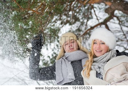 Romantic lovely couple in snowy nature. Romantic Lovely Couple Having Fun In A Snowy Forest