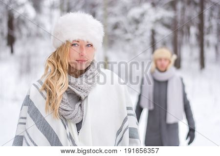 Romantic lovely couple in snowy nature. The love story.