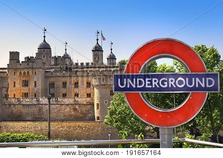 LONDON, ENGLAND - May 25,2017: Tower of London, symbol of the old city and Underground, symbol of the modern city in London, England