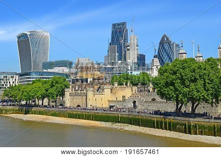 LONDON, ENGLAND - May 24,2017: Tower of London against the background of modern skyscrapers of London, England
