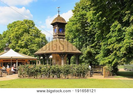 cafe and clock tower at the entrance to the Diana, Princess of Wales Memorial Playground in Kensington Gardens, London