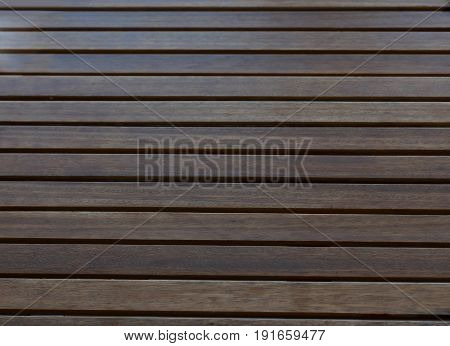 Dark brown wood lath background ad texture