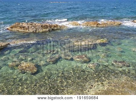 Clear water and gentle waves of Aegean sea at Chania, Crete Island, Greece