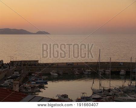 Old Port of Heraklion with beautiful sunset sky background, Crete Island of Greece