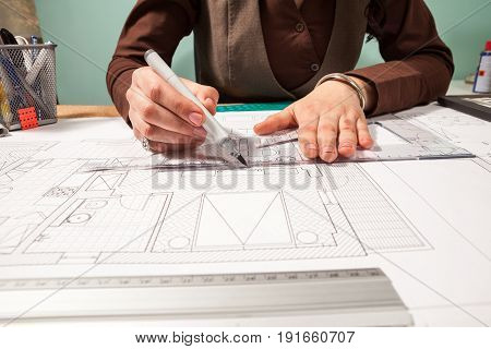 Close up of architect working on blueprints. Design and pan. Professional drawing of architect plans