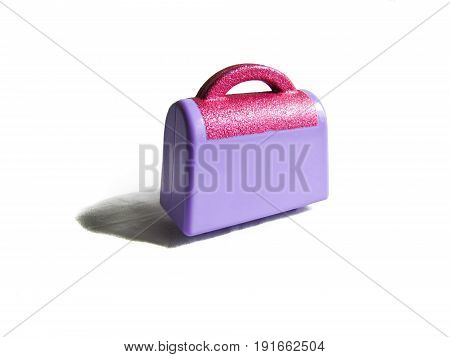 children's toy purple suitcase with sparkles isolated on white background