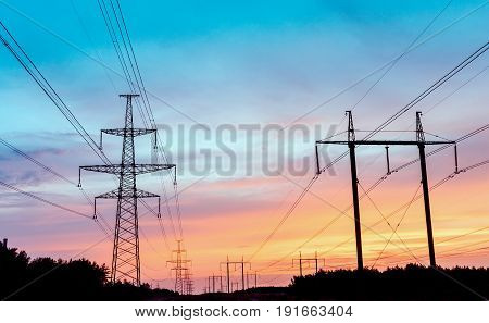 Electricity pylon in a field with blue sky