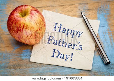 happy father's day - handwriting on a napkin with apple