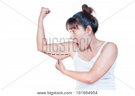 asian woman checking her upper arm and she agape