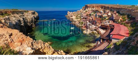 Aeril panorama of Popeye Village in the sunny day, Malta