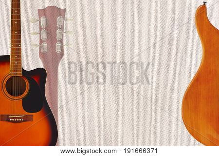 Acoustic and electric guitars and headstock on the cardboard background with plenty of copy space.