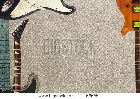 Black and grey electric classic guitars mahogany gutar and neck on the rough cardboard background with plenty of copy space.