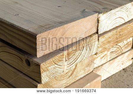 Stack Of New Wooden Studs At The Lumber Yard. Wood Timber Construction Material. Shallow Depth Of Fi