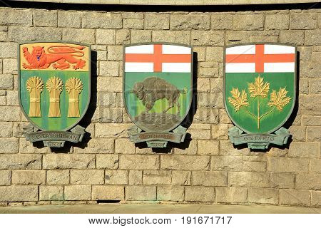 Victoria BC,Canada,August 9th 2014.Coats of arms for the Canadian provinces of Saskatchewan,Manitoba and Ontario hang on a wall in Victoria