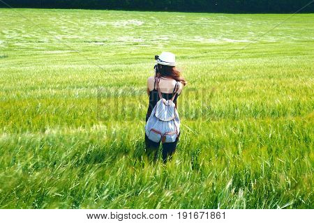 Woman making a photo in a agricultural field . Photographer. Traveler lifestyle. Woman with camera