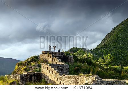 BUDVA, MONTENEGRO - OCTOBER 7, 2016: A travelers on the ruins of medieval fortress Mogren at the shore of Adriatic sea