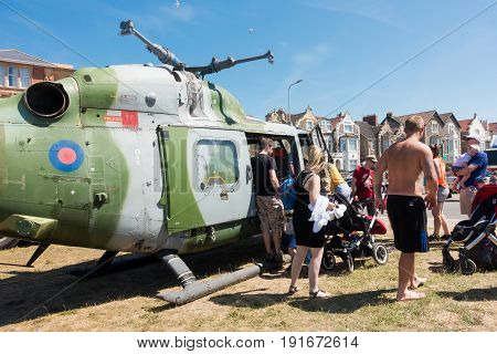 Weston-super-Mare United Kingdom - June 17 2017: People are queuing to have a look inside the helicopter at the public and free Airshow in Weston-super-Mare 2017
