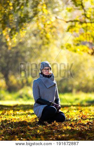 Beautiful autumn portrait of a woman. Autumn leaves, colorful view, beautiful girl.