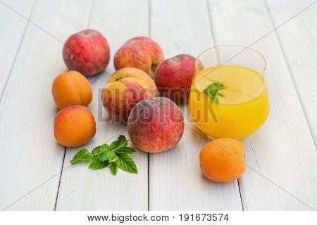 Composition with apricots and nectarines on a white table