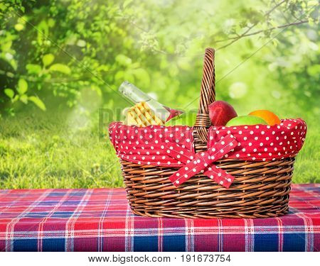 picnic basket and blanket on a table