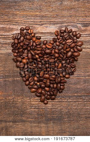 Heart shape made from coffee beans. Love for coffee, high quality, endorsement, favorite cafe concept