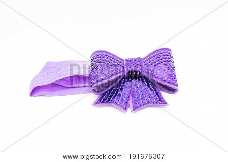 one women's accessory purple bow on head headband for baby girl isolated on white background the concept of fashion