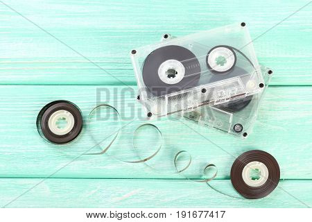 Cassette tapes on the mint wooden table