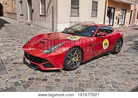GATTEO, FC ITALY - MAY 19: crew on a sportscar Ferrari F12 Berlinetta in rally