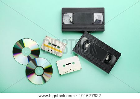 Video And Music Cassette Tapes With Cd Disk On Mint Background