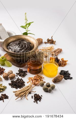 Indian Ayurvedic dietary supplement called Chyawanprash / chyavanaprasha  is a cooked mixture of sugar, honey, ghee, Indian Gooseberry (amla), jam, sesame oil, berries, herbs and various spices
