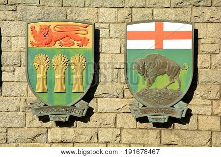 Victoria BC,Canada,September 9th 2014.The costs of arms for the Canadian provinces of Saskatchewan and Manitoba hang on a wall in Victoria.