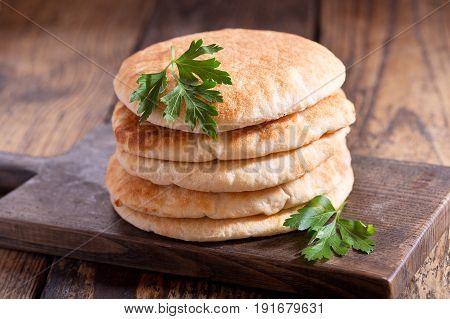 Pita Bread On A Wooden Board
