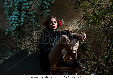 Woman With Closed Eyes And Glass Sitting On Chair