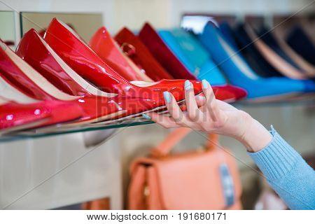 Hand Choose Shoes At Shopping Showcase