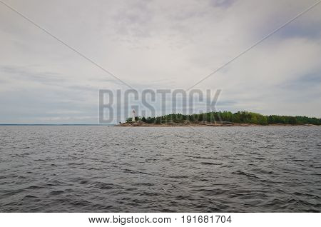 Lighthouse on a rocky island in the Baltic Sea