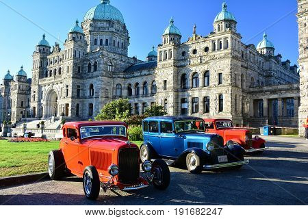 Victoria BC,Canada,July 24th 2015.Classic cars lined up in front of the parliament buildings in Victoria BC .