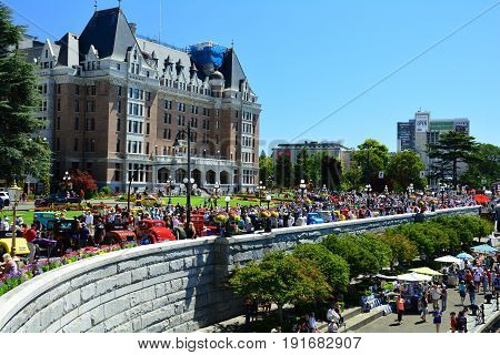 Victoria BC,Canada,July 24th 2016.Classic car show in front of the Empress hotel in Victoria brings out the crowds on a beautiful day to see these classy autos next to  Victoria's famous inner harbor.