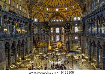 ISTANBUL, TURKEY - SEPTEMBER 29: Hagia Sophia indoor shot of the main hall with tourist groups on September 29, 2011 in Istanbul.